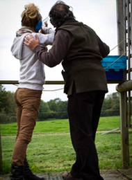 Clay Pigeon Shooting giving a lady from a hen party some coaching