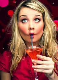Woman from a hen party Drinking A Cocktail Pulling A Face
