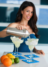 Woman showing a hen party how to Make Cocktails