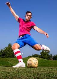 Footgolf player from a stag party just about to kick a ball