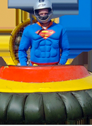 Man Dressed As Superman Driving a Hovercraft