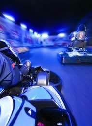 Stag Party Racing Indoor Karts in a blue light