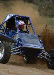 Rage Buggy kicking up dirt And Racing