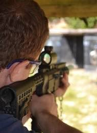Looking through a sight on a rifle