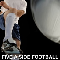 Man kicking a football