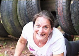 Lady From A Hen Party taking part in an Assault Course