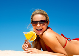 Lady Drinking a Cocktail on a Beach