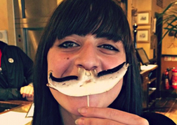Lady Using a Mushroom as a Moustache