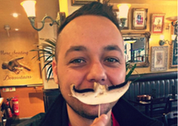 Man from a stag party Using a Mushroom as a Moustache