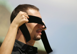 Man having a blindfold put on for blindfold driving