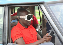 Man Blindfolded and driving