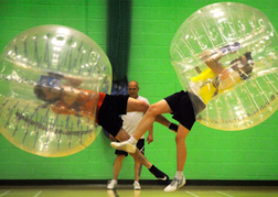 stag party playing bubble football & Smashing together