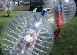 group playing Bubble Football whilst on a stag weekend