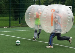 Bubble Footballers Running For The Ball