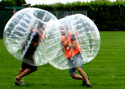 stag party playing Bubble Football coming together