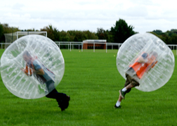 stag party playing Bubble Football in mid hit