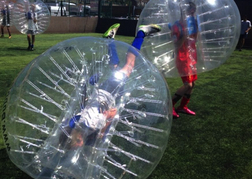 stag party playing Bubble Football one man rolling over