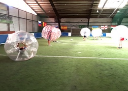 Indoor bubble football pitch with a stag party in Hamburg
