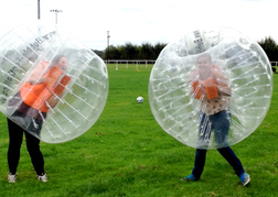 Ladies playing Bubble Football on a hen weekend