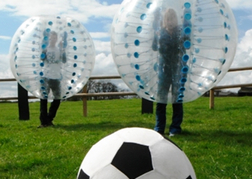 Bubble Football Leeds close up of football with zorbs behind