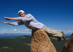 Man Being Silly On a rock
