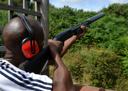man taking part in Clay Pigeon Shooting whilst on a stag do