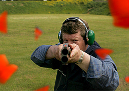 Man Shooting A Clay Pigeon