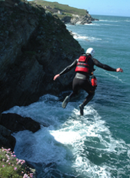 Man from a stag party in Mid Jump whilst Coasteering