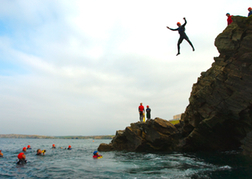 Man In Mid Air Whilst Coasteering