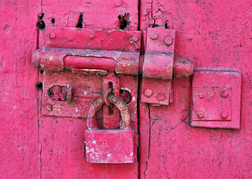 Pink door, bolt and padlock