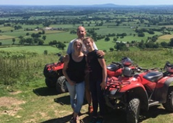 Father and daughters quad biking in North Wales