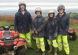 A family posing by their Quad Bikes in North Wales