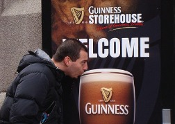 Man pretending to take a sip of Guinness