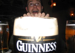 Man Behind Super Sized Glass of Guinness