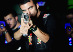Man aiming playing Laser Tag