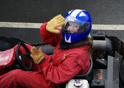 Hen Saluting from a Kart