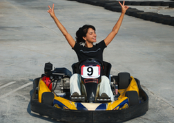 Lady winning a kart race