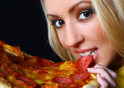 Lady Eating a Pizza