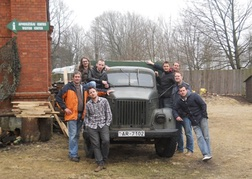 Stag Party on the prison tour sat on an old Russian military vehicle