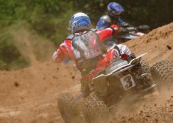 Quad Bike Racing Kicking Up Dust