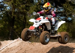 Quad bike going over a hump on a trek
