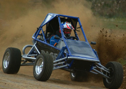 A Rage Buggy Kicking up Dust
