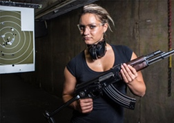 A Lady holding a Rifle Shooting in Hamburg