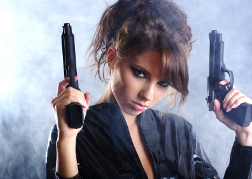 Lady Holding Up Smoking Handguns