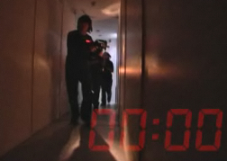 Spy Mission Image 2 men in a corridor with a clock on screen