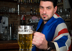 Bar Man in Union Jack Flag Giving you a beer