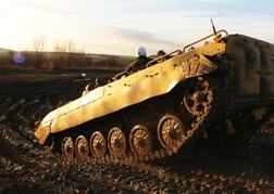 Tank Driving up a muddy hill
