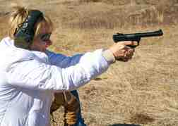 Lady from a hen party hand gun shooting