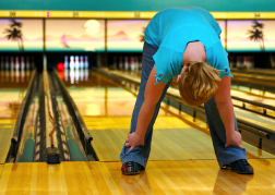 Lady playing Ten Pin Bowling