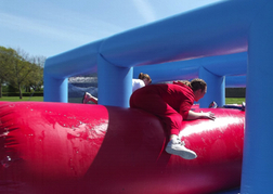 Totally Wiped Out Inflatables with a man in red